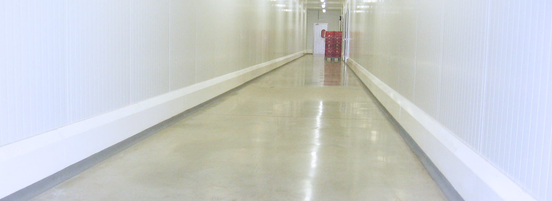 Hallway with curbs and crates