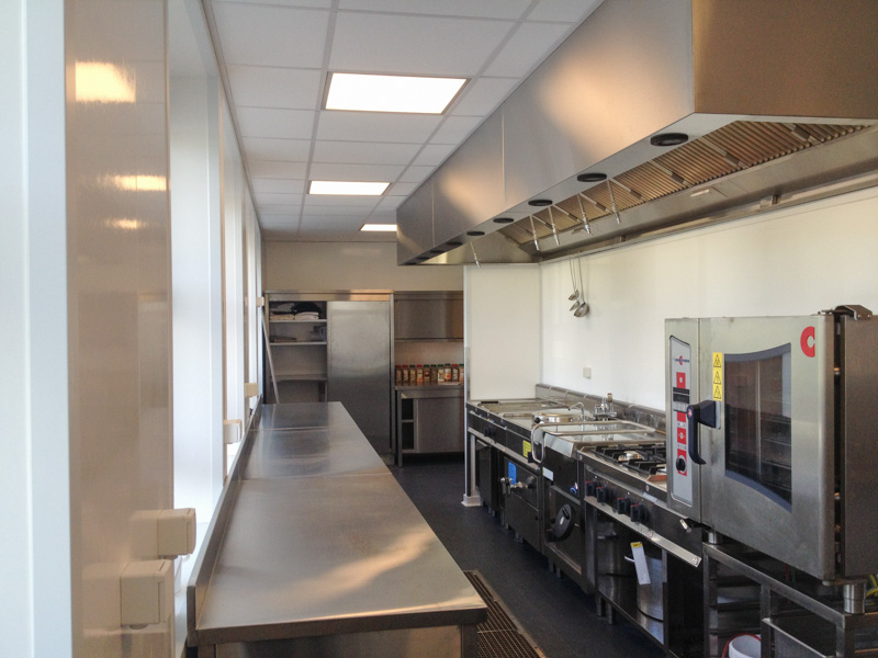 kitchen in bakery with hygienic walls and ceiling