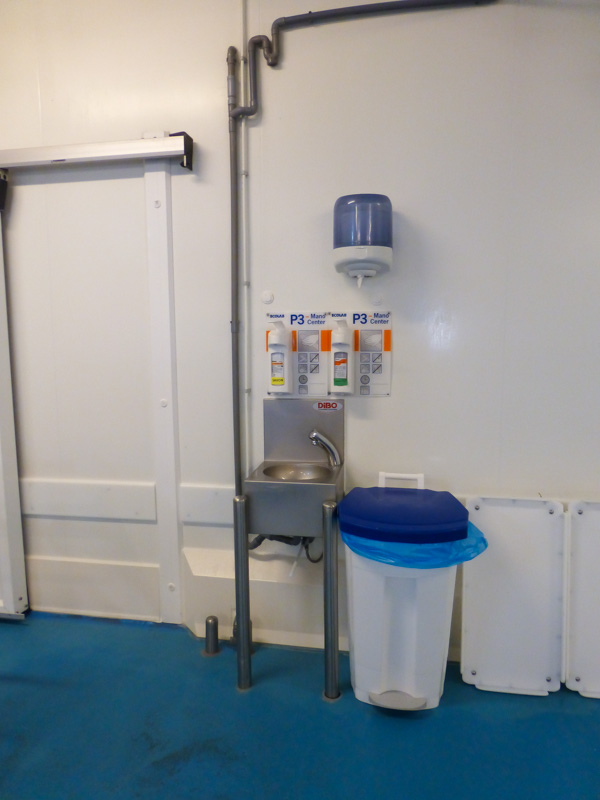 cleaning products on hygienic wall fish processing plant