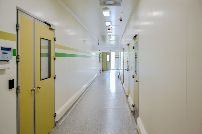 Clean and flush FRP walls in corridor pharma