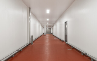 Meat processing plant with hygienic FRP walls and ceilings